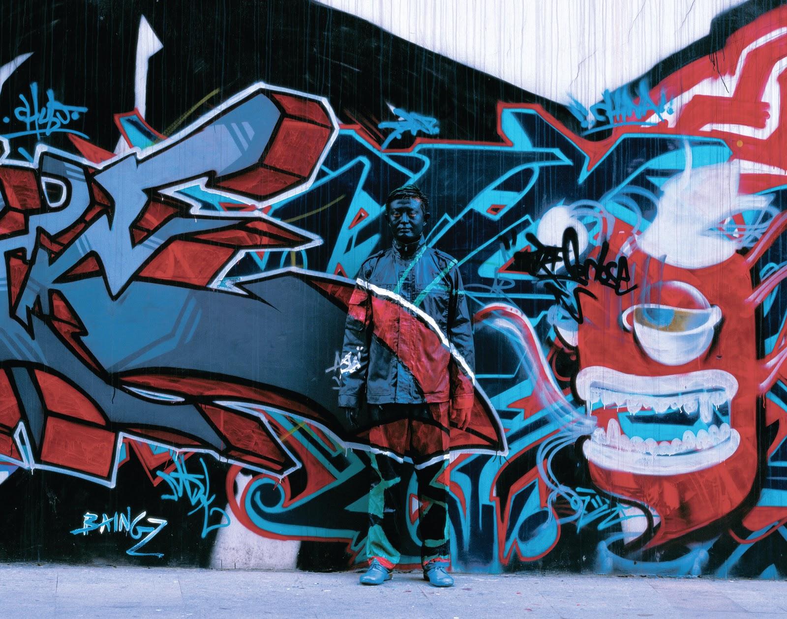 Liu_Bolin_HITC_No_69_Graffiti_photograph___120x95cm_2008